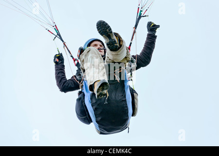 paragliding para gliding parachute in the sky floating effortlessly - Stock Photo
