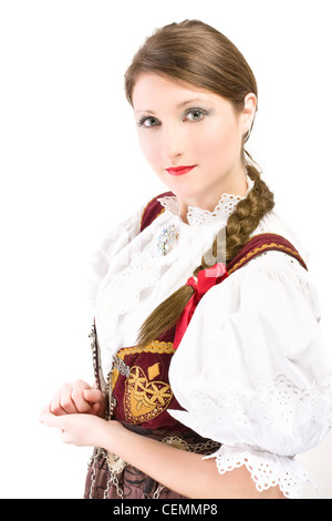 Beauty woman in traditional Polish clothes Cieszyn Silesia region, studio shot on white background - Stock Photo