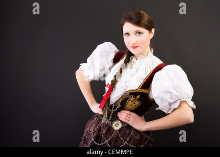 Beauty woman in traditional Polish clothes Cieszyn Silesia region, studio shot on black background - Stock Photo