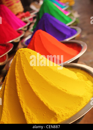 Colorful piles of powdered dyes used for holi festival on display in an indian shop at mysore - Stock Photo