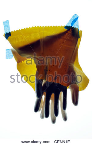 broken household working gloves with blue tape - Stock Photo