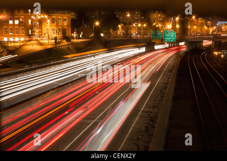 Streaks of lights of moving vehicles on the road, Mass Turnpike, Boston, Massachusetts, USA - Stock Photo