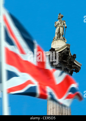 Union Jack with Nelson's Column in background. The column was built between 1840 and 1843 to commemorate Admiral - Stock Photo