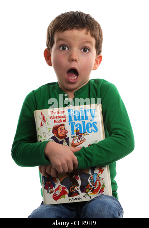 Boy with a book of Fairy Tales - Stock Photo