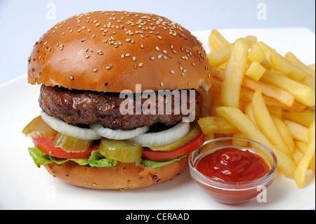 Hamburger with french fries and ketchup - Stock Photo
