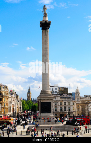 Tourists visiting Nelson's Column in Trafalgar Square. - Stock Photo