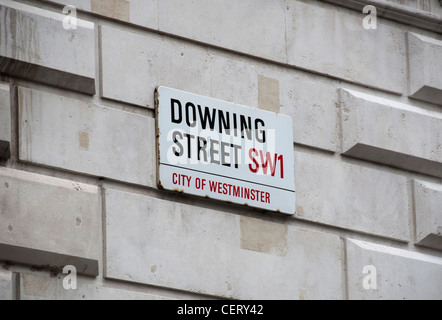 Street name sig depicting Downing Street the home of the Prime Minister for The UK situated in the City of Westminster - Stock Photo
