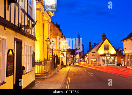 Light trails from cars in Diss town centre at dusk. - Stock Photo