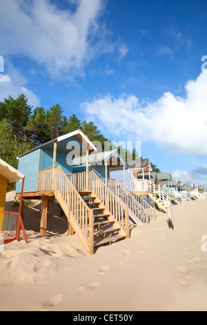 Colourful beach huts along the seafront at Wells-next-the-Sea. - Stock Photo