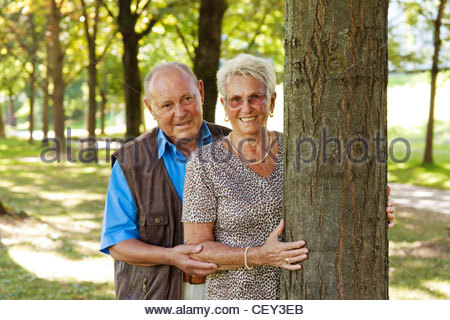 mature senior couple in love. it gives a rose. - Stockfoto