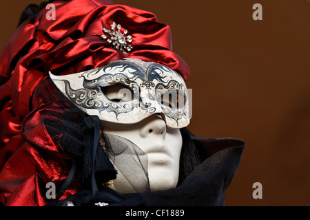 Masked woman at the Carnival in Venice, Italy - Stock Photo