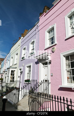 Pastel coloured terrace houses in Bywater Street. - Stock Photo