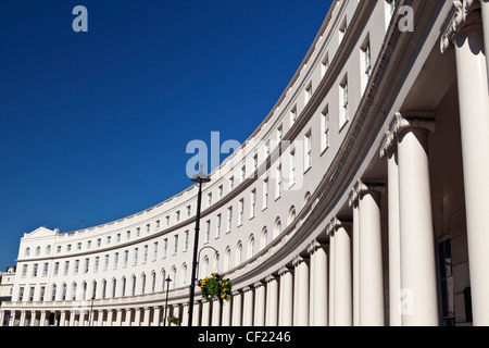 Stuccoed semicircular terraced houses by the architect John Nash in Park Crescent near Regent's Park. - Stock Photo