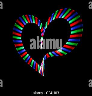 Multi-coloured shone heart on black background. Love symbol. - Stock Photo