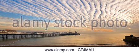 Stunning cloud formations over Brighton Pier at sunset. - Stock Photo