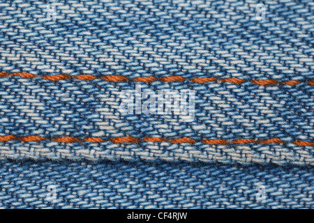 wear a piece of blue denim structure of the yellow line, close-up photography - Stock Photo