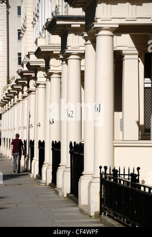 Numbered stone columns outside elegant Victorian terraced houses in Eccleston Square. - Stock Photo