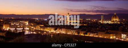 Panoramic view of Ponte Vecchio, River Arno, Palazzo Vecchio and Duomo in evening light from Piazzale Michelangelo, - Stock Photo