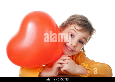 laughing little girl holds heart shape balloon isolated on white background - Stockfoto