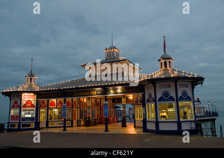A view of the entrance to Eastbourne Pier at dusk. - Stock Photo