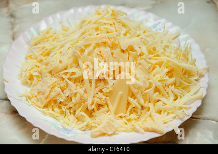 grated cheese at plate - Stock Photo