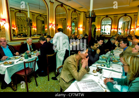 PARIS, France, - Adults Sharing Meals in Dining Room of Traditional French Bistro Restaurant. Business Lunch at - Stock Photo