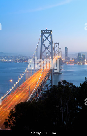 USA, California, San Francisco, Oakland Bay Bridge at dusk and City Skyline - Stock Photo