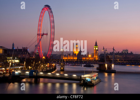Big Ben Clock Tower of Houses of Parliament and Millennium Wheel or London Eye at dusk London England UK - Stock Photo