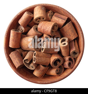 cinnamon sticks in a wooden bowl isolated on white background - Stock Photo
