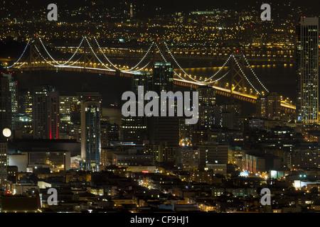 San Francisco California Cityscape with Oakland Bay Bridge Lit at Night - Stock Photo