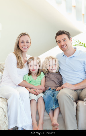 Family sitting on the couch - Stock Photo