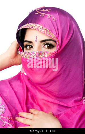 Beautiful Bengali Indian Hindu woman holding colorful headscarf veil in front of face, isolated - Stockfoto