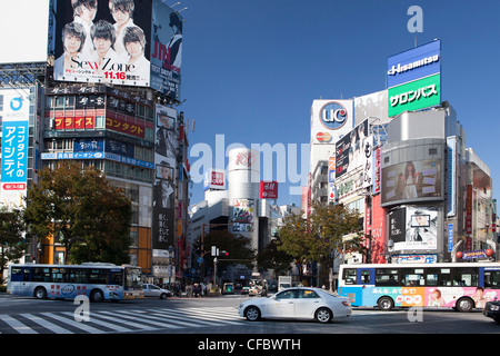 Japan, Asia, Tokyo, city, Shibuya, West Shibuya, Station, advertisement, blue, busy, colourful, crossing, shopping, - Stock Photo