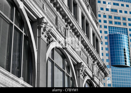 Contrasting architecture; the historic Paris Building and modern Canwest Tower. Portage Avenue, Winnipeg, Manitoba, - Stock Photo