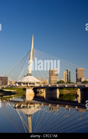 Winnipeg skyline showing close-up of the Esplanade Riel foot bridge over the Red River, from St. Boniface, Manitoba, - Stock Photo
