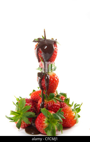 Picture of a tower of strawberries with melted chocolate poured over - Stock Photo