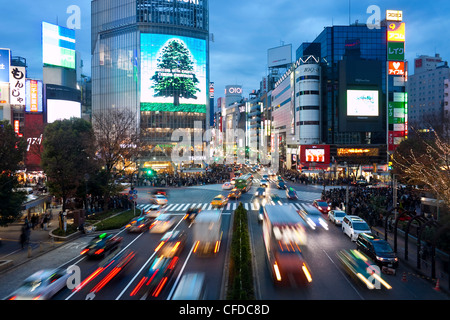 The Shibuya Crossing intersection, Shibuya, Tokyo, Japan - Stock Photo