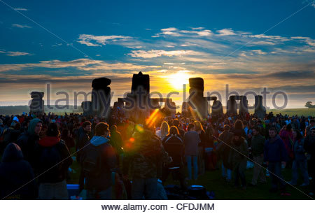 Sunrise at Summer Solstice celebrations, Stonehenge, UNESCO World Heritage Site, Wiltshire, England, United Kingdom, - Stock Photo
