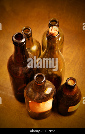 Old tagged bottles with transparent liquid close-up - Stock Photo