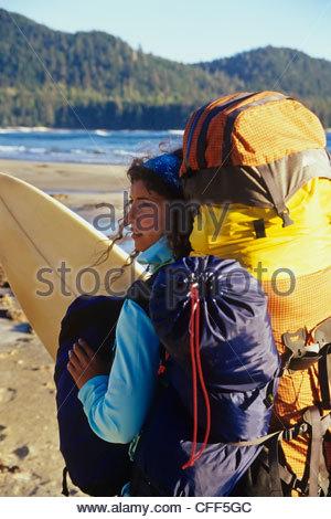 Surfer on the remote west coast beach, British Columbia, Canada. - Stock Photo
