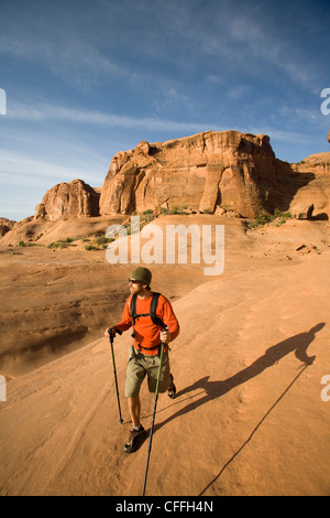 Young man hiking in Arches National Park near Moab, Utah. - Stock Photo