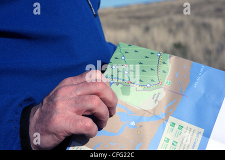 Hand holding an outdoor map - Stock Photo