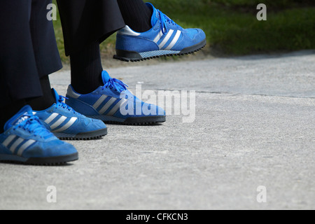 Matching Blue Shoes of Couple Sitting on Park Bench - Stock Photo