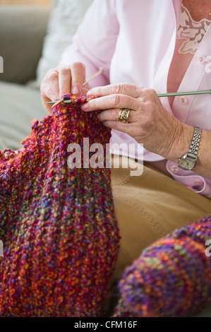 USA, New Jersey, Jersey City, Senior woman knitting, close-up - Stock Photo