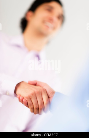 USA, New Jersey, Jersey City, Two businessman shaking hands - Stock Photo