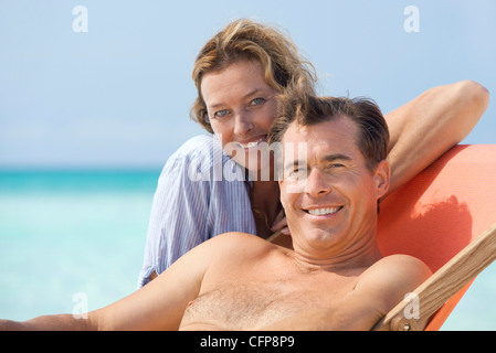 Couple spending time at beach, portrait - Stockfoto