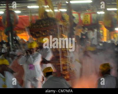 Malaysian ethnic Chinese poeple walk on burning charcoal on the last day of the Nine Emperor Gods festival in Kuala - Stock Photo