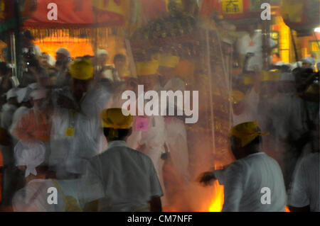 Malaysian ethnic Chinese poeple walk on burning charcoal while carrying an nine emperor on the last day of the Nine - Stock Photo