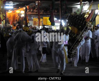 Malaysian ethnic burn a joss-stick on the last day of the Nine Emperor Gods festival in Kuala Lumpur, Malaysia, - Stock Photo