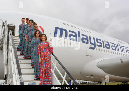 Farnborough International Airshow 2012. 9-07. 2012 . Malaysia Airlines new Airbus A380 with Cabin air crew. - Stock Photo